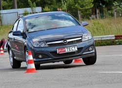 Чуть жестче, чуть резче, но и на пару километров в час быстрее, чем С4 Coupe, – это Opel Astra GTC на «переставке».