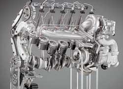 Блоки цилиндров новых 6-цилиндровых дизелей – из алюминиевого сплава. Мотор вооружен двухступенчатым турбонаддувом и пьезофорсунками с давлением впрыска 2000 бар.