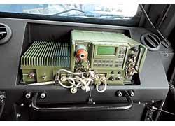 Экран заднего обзора и блок климат-контроля соседствуют с навигатором (ГЛОНАСС+GPS), рацией, прибором радиационной разведки и прочим.