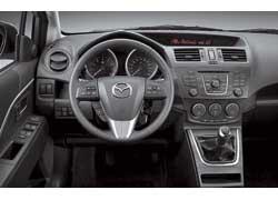 Самая яркая деталь интерьера – острый «козырек» панели приборов.  Его форма ассоциируется со столь любимым Mazda роторным мотором. Машина будет предлагаться как в 5-, так и в 7-местном исполнении.