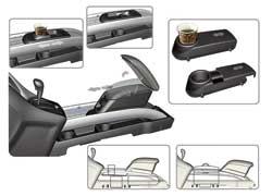 Между передними креслами расположены направляющие FlexRail, накоторые могут крепиться подлокотники, подставки иполки.