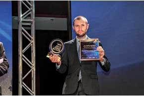 Директор по маркетингу Группы компаний «АИС» Сергей Боровик получил статуэтку за пикап SsangYong Actyon Sports.