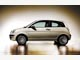Lancia Ypsilon. Необычный облик подчеркивают выштамповки, визуально облегчающие силуэт.