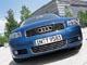 Audi A3. Большая решетка радиатора и «нахмуренные» фары подчеркивают твердый характер машины.