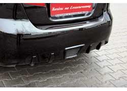 Под зарешеченным диффузором заднего бампера можно спрятать выхлопную систему любого ценового уровня.